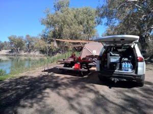 """The campsite all finished, the Coleman """"Instant Up"""" tent is truly a simple set up and we parked the car next to the picnic table and extended it's awning over the table for a nice shady eating spot."""